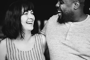 Diverse couple laughing together
