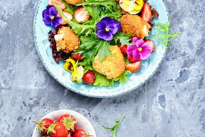 Salad leaves with strawberries,herbs
