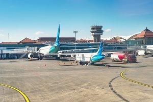 Airplanes and truck at runway Bali