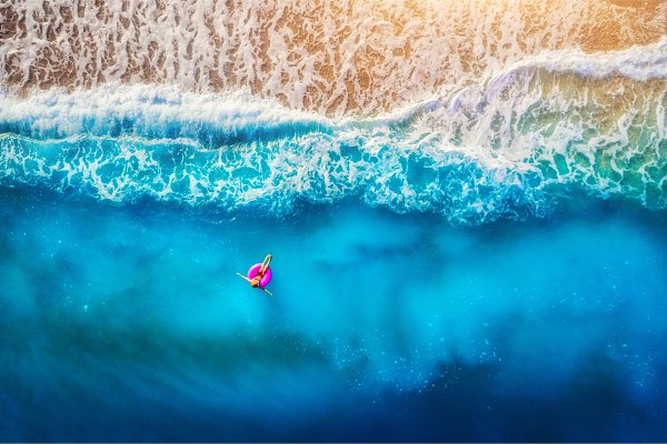 Aerial view of young woman swimming…