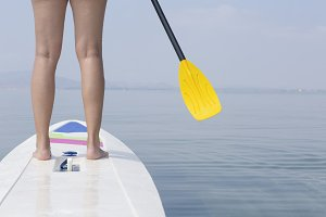 woman and paddle board