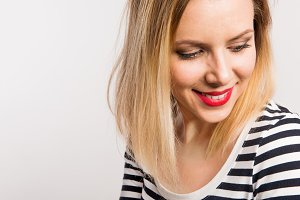 Portrait of a young beautiful woman with black and white striped top. Copy space.