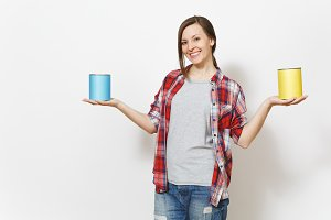 Young smiling beautiful woman in casual clothes holding empty paint tin cans with copy space isolated on white background. Instruments, accessories for renovation apartment room. Repair home concept.