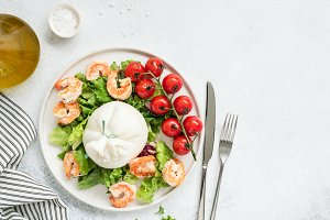 Healthy salad with burrata cheese