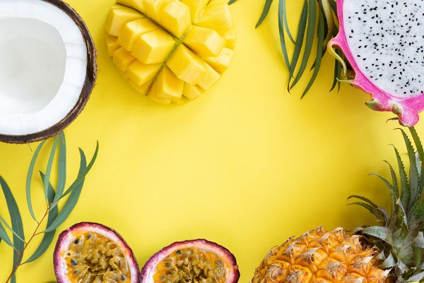 Tropical fruits on yellow