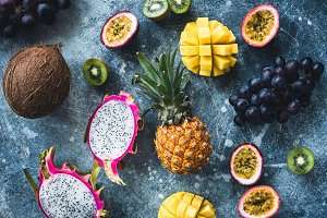 Tropical fruits on stone background