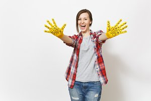 Young overjoyed woman showing hands in building yellow gloves with fun print on camera isolated on white background. Accessories for renovation apartment room. Repair home concept. Advertising area.