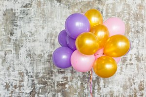 Bright balloons bunch against a