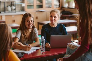 Happy students discussing studies