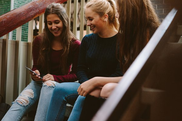 Education Stock Photos: Jacob Lund - High school girls sitting