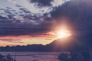 The sunrise over a lake and mountains. The place is close to volcano Batur, Bali island.