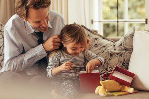 Father and daughter opening a gift