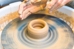womens hands of a potter creating an