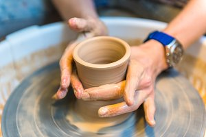 Pottering - creating a clay cup in