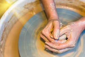 womens hands of a potter creating an