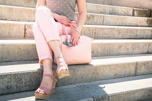 Woman in pink with bag