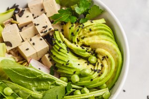 Green buddha bowl with tofu