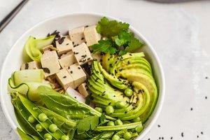 Green buddha bowl with tofu