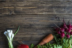 overhead raw diet food on dark table with copy space for text
