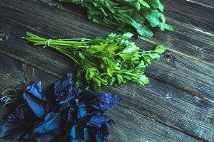 basil parsley sorrel herbs assortie on a wooden table