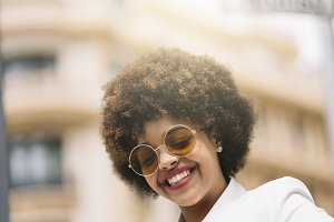 Afro girl with mobile phone.