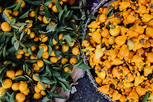 tangerines and yellow fruits in larg