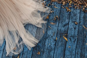 pink wedding dress on a blue wooden