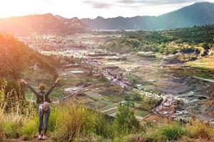Woman sstanding on mountain in morning. Bali island.