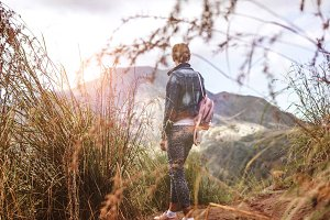 Woman standing on mountain in morning. Bali island.