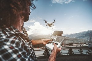 Man with remote controller, drone