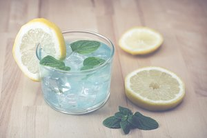 Gin and tonic blue with mint leaves