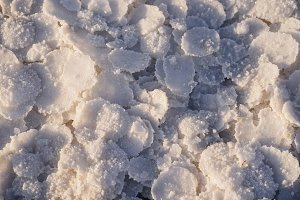 natural white salt frozen in circles