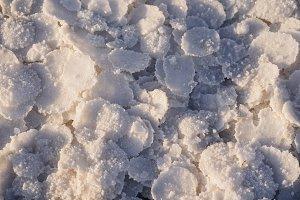 natural white salt frozen in circles