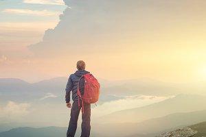 Tourist on the peak of high rocks