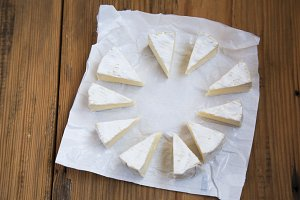 Pieces of round cheese brie