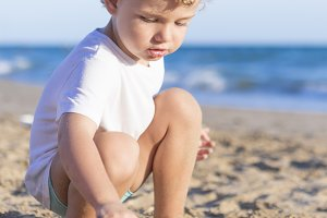 child playing with the sand
