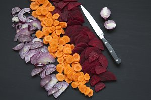 Chopped fresh vegetables with knife