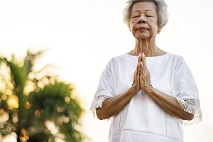 Seniors woman practicing yoga