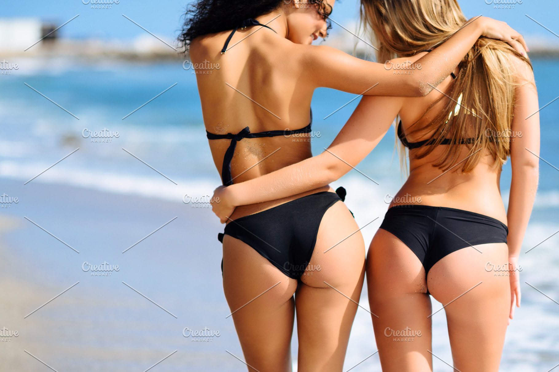 4f3e58da27f38 Young women in black bikini on beach ~ People Photos ~ Creative Market