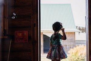 girl on the threshold of a village