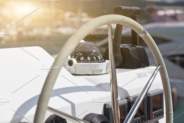 Sailing yacht control wheel ~ Transportation Photos ~ Creative Market