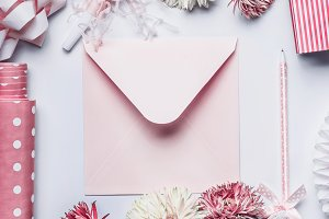 Greeting with pastel pink envelope