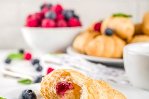 Home baked croissants with berries
