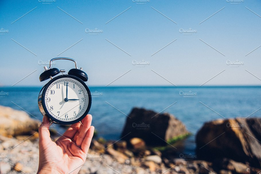 Hand Hold Watch On Beach Background Alarm Clock Sea And Sand Diffe Time