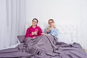 Two friends girls in pajamas