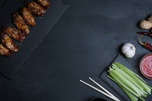 Traditional Asian stir fry chicken wings with sesame and vegetables