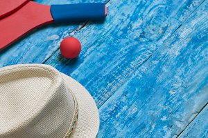Equipment for playing beach tennis on the blue wooden background