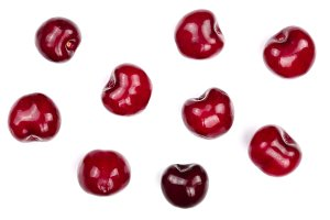 Sweet red cherries isolated on white background. Top view. Flat lay pattern