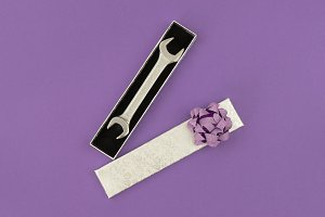 Gift box with wrench on violet