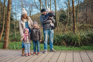 Happy family enjoying together leisure in the forest